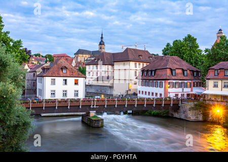 BAMBERG, GERMANY - JUNE 19: People on a bridge accross the river Regnitz in Bamberg, Germany on June 19, 2018. - Stock Photo