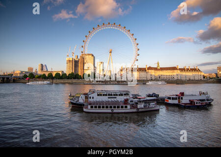London, England, UK - June 12, 2018: New skyscrapers are under construction at the Shell Centre behind the London Eye observation wheel on the South B - Stock Photo