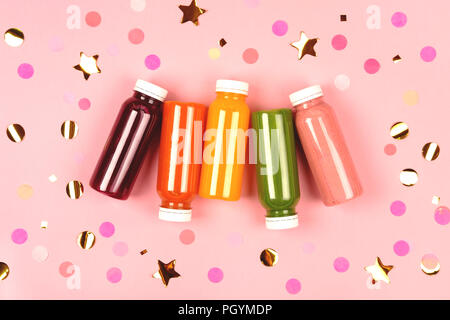 Bottles of multicolored smoothies - Stock Photo