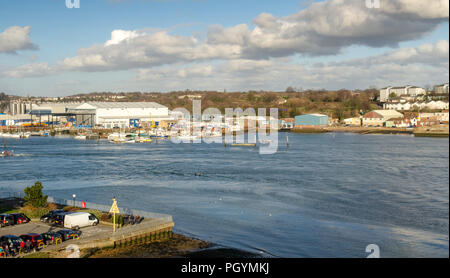 Southampton, England, UK - February 16, 2014: A First Great Western Railway train runs alongside the River Itchen in the suburbs of Southampton. - Stock Photo