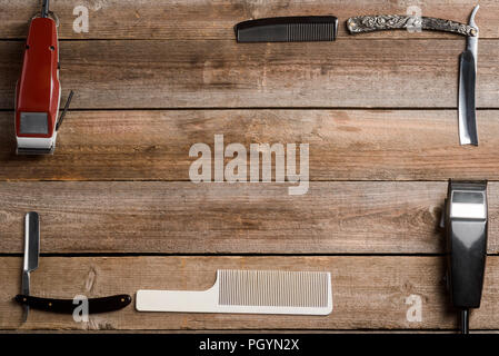 Electric hair trimmers and combs - Stock Photo