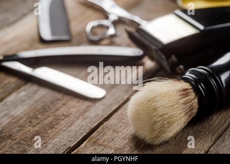 Brush on wooden surface - Stock Photo