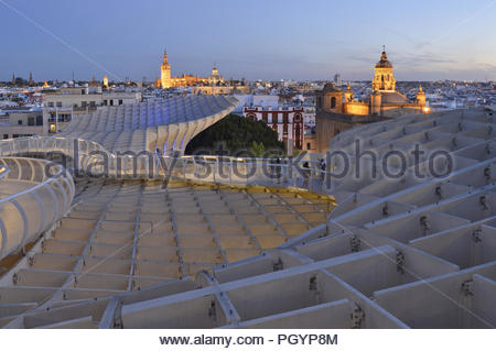 Churches and Cathedrals - old town of Seville at dusk viewed from modern Metropol Parasol in Andalusia Southern Spain Europe. - Stock Photo