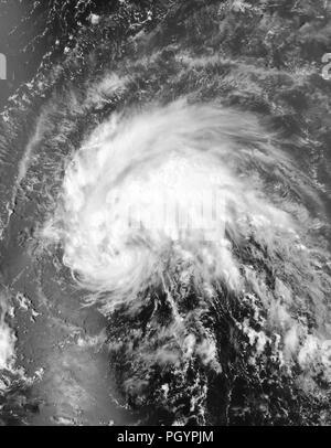 Tropical storm Irene approaching Puerto Rico, taken from the NASA's Aqua satellite, 2011. Image courtesy NASA Goddard MODIS Rapid Response Team. () - Stock Photo