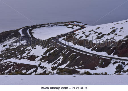 TF-24 road through volcanic landscape covered with snow. High altitude of 2100 m above sea level, Teide National Park Tenerife Canary Islands Spain. - Stock Photo
