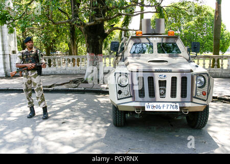 Kolkata, India - April 6, 2018 : young indian soldier guard holding light machine gun and marksman armoured vehicle are observed for anti-terrorism in - Stock Photo