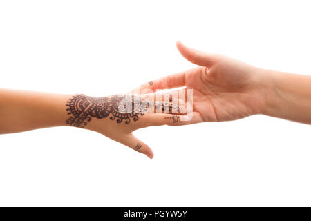 Child hand with traditional henna tatoo holding mother's hand isolated on white background. Love, parenting and connection. - Stock Photo