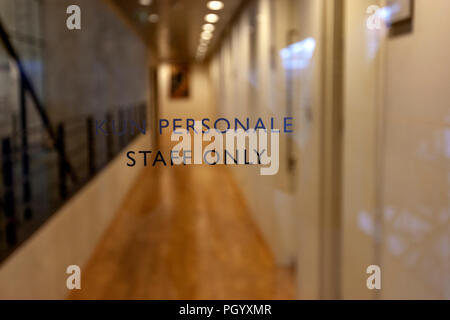 Kun Personale, Staff Only, in a door at the Royal Danish Library, The Black Diamond library, Copenhagen - Stock Photo
