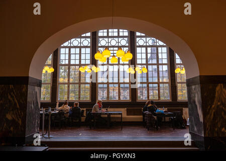 Studying in the cafeteria of the Royal Danish Library The old building, The Black Diamond library, Copenhagen, Denmark. - Stock Photo