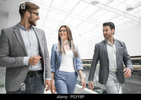 group of managers talking in the business cente - Stock Photo