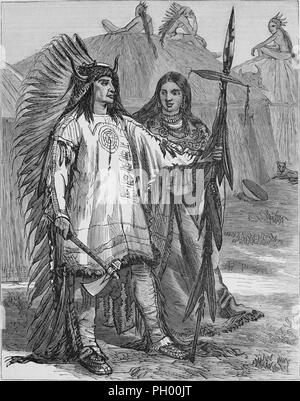 Black and white vintage print, depicting the Mandan Chief Mato-tope, aka Four Bears, standing in full length, three-quarter view, wearing full ceremonial garb, including a feathered headdress, made of ermine, with horns on either side, and holding a hatchet and a lance, with his wife, Brown Woman, standing slightly behind him, wearing a similar but longer tunic, and men seated on top of large, circular earth lodges in the background, located in North America, published in John George Wood's volume 'The uncivilized races of men in all countries of the world, being a comprehensive account of the - Stock Photo
