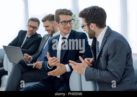 group of business people sitting in the office waiting room - Stock Photo