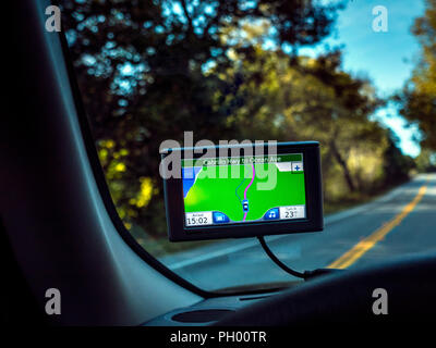 Satellite Navigation Sat Nav screen from drivers point of view, displaying route Cabrillo Highway to Ocean Avenue, Pacific Grove California USA - Stock Photo