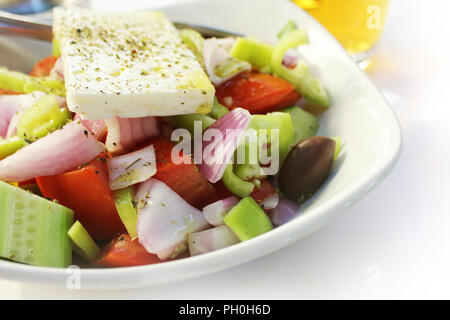 Greek salad with fresh vegetables feta cheese, cucumber,pepper,tomatos and black olives. Vegan food. Healthy food. - Stock Photo