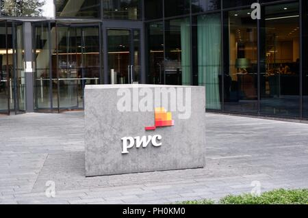 PWC office at More London complex, London (UK).  PWC is a professional services firm which provides audit, tax and advisory services worldwide. - Stock Photo