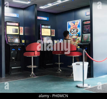 Fixed odds betting terminals (FOBT) in Betfred betting office. UK - Stock Photo