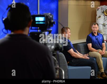 Alexey Ovchinin, Russian Roscosmos cosmonaut, and Col. Nick Hague, NASA astronaut, discuss their upcoming trip to the International Space Station, during a news conference at the Johnson Space Center in Houston, June 18, 2018. The two will journey to the ISS on Oct. 11, 2018, aboard the Roscosmos Soyuz MS-10 spacecraft, launched from Baikonur Cosmodrome in Kazakhstan. - Stock Photo