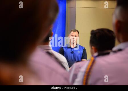 Col. Nick Hague, NASA astronaut, discusses his upcoming trip to the International Space Station, during a news conference at the Johnson Space Center in Houston, June 18, 2018. Hague and Alexey Ovchinin, Russian Roscosmos cosmonaut, will journey to the ISS on Oct. 11, 2018, aboard the Roscosmos Soyuz MS-10 spacecraft, launched from Baikonur Cosmodrome in Kazakhstan. - Stock Photo
