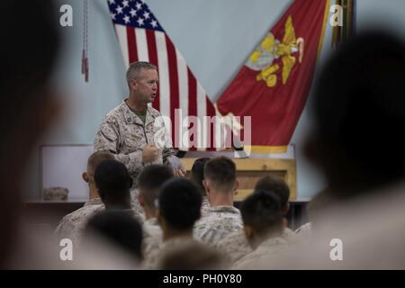 UNDISCLOSED LOCATION, MIDDLE EAST – U.S. Marine Corps Sgt. Maj. William T. Thurber, the Sergeant Major of U.S. Marine Corps Forces Central Command (MARCENT), addresses Marines with Special Purpose Marine Air-Ground Task Force, Crisis Response-Central Command during a town hall meeting June 22, 2018.  Thurber and Lt. Gen. William D. Beydler, the MARCENT commanding general, spoke to Marines about readiness and recognized top performers with challenge coins. - Stock Photo