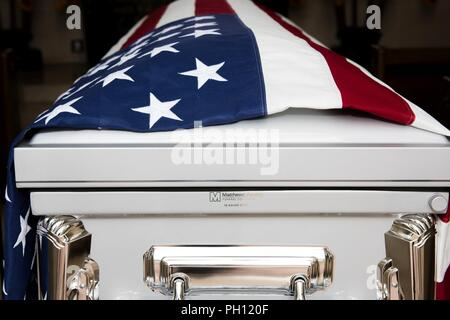 """NORMANDY, France (June 19, 2018) The remains of Radioman 2nd Class Julius """"Henry"""" Pieper rest in a chapel at Normandy American Cemetery prior to Pieper's funeral service. Henry Pieper and his twin brother, Radioman 2nd Class Ludwig """"Louie"""" Pieper, were both killed when their ship, Landing Ship Tank (LST) 523, struck an underwater mine off the coast of France on June 19, 1944. Louie's remains were found immediately, but Henry's remains weren't identified until December 2017. The family requested that Henry be buried in Normandy next to his brother. - Stock Photo"""