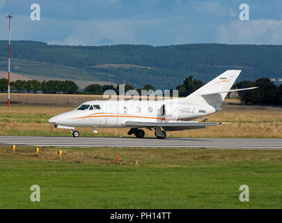 A new arrival at Inverness Dalcross Airport in the Scottish Highlands is this French built Dassault Falcon 100. - Stock Photo