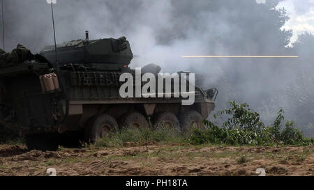 Infantrymen with the 1st Squadron, 2nd Cavalry Regiment fire a Stryker 30mm Infantry Carrier Vehicle – Dragoon (ICVD) during a joint combined arms live fire exercise Aug. 26-30 at Bemowo Piskie Training Area, Poland. 1-2 Cav. Regt. became the first squadron in the U.S. Army to field the newly upgraded dragoon strykers. The CALFEX is designed to maintain readiness and build interoperability among BPTA Soldiers. The Soldiers are on a six-month rotational assignment in support of the multinational battle group comprised of U.S., U.K., Croatian and Romanian Soldiers who serve with the Polish 15th  - Stock Photo
