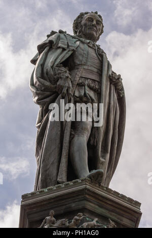 Edinburgh, Scotland, UK - June 14, 2012; Fish eye shot on Statue of Walter Montagu Douglas Scott, Duke of Buccleuch on Parliament Square. cloudscape. - Stock Photo