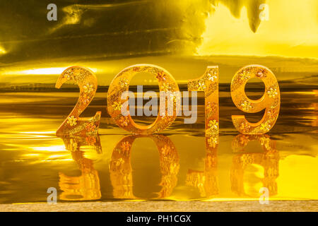 2019 is made in gold color place in golden background is - Lucky color for new year 2019 ...