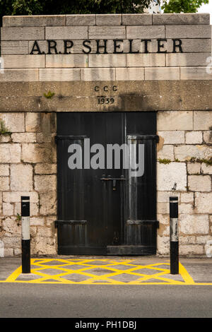 Gibraltar, Line Wall Road, Second World War ARP Air Raid Shelter entrance, dated 1939 in wall of King's Bastion - Stock Photo