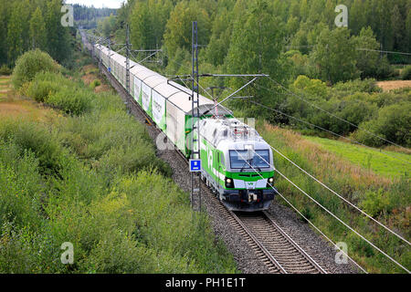 ORIVESI, FINLAND - AUGUST 27, 2018: VR Freight train travels through green late summer landscape in Central Finland, elevated view from a bridge. - Stock Photo