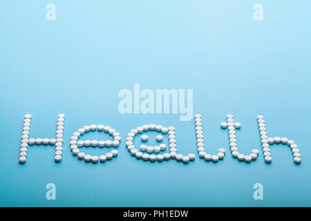word text is made up of pills, health concept - Stock Photo