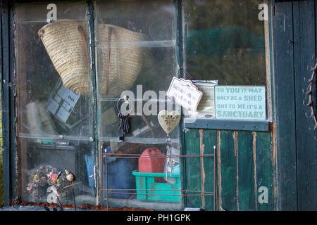 Shed on allotment Mill Hill, London, UK, with interesting and creative artefacts artifacts  and other objects, to be physical active and outside. - Stock Photo
