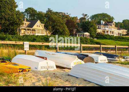 Dinghies lined up on a private beach near Owen Park Beach in Vineyard Haven (Tisbury), Massachusetts on Martha's Vineyard. - Stock Photo