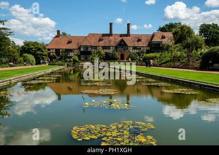 Looking down The Jellicoe Canal with Water Lillies towards The Laboratory Wisley Gardens Surrey England UK July2018 - Stock Photo