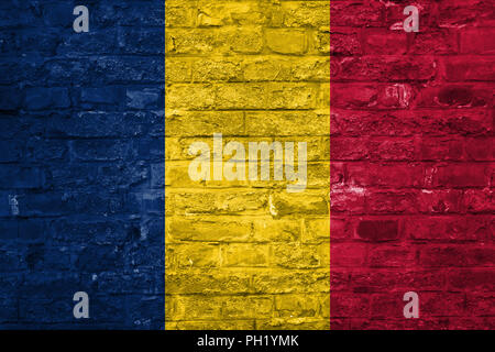 Flag of Chad over an old brick wall background, surface - Stock Photo