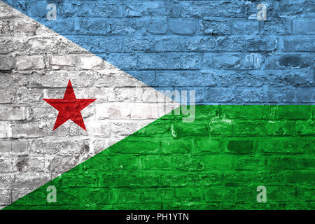 Flag of Djibouti over an old brick wall background, surface - Stock Photo