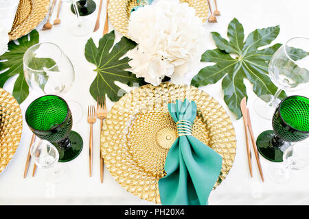 Beautiful banquet hall under a tent for a wedding reception. Interior of a wedding tent decoration ready for guests. Decor flowers. Green theme - Stock Photo