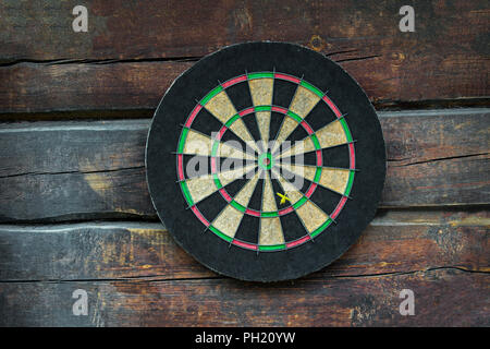 Dart board on old wooden table. Business concept. - Stock Photo