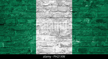 Flag of Nigeria over an old brick wall background, surface - Stock Photo