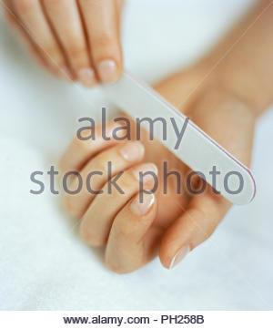 Woman filing nails - Stock Photo