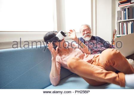 Senior couple using virtual reality headset - Stock Photo