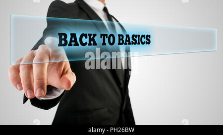 Businessman Pressing Back to Basics Text on Transparent Glass. - Stock Photo
