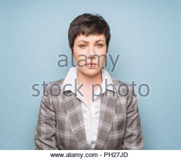 Portrait of young woman with short hair - Stock Photo