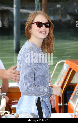 VENICE, ITALY - August 30 : Emma Stone leaves after The Favourite Photocall during the 75th Venice Film Festival at Sala Casino on August 30, 2018 in Venice, Italy. - Stock Photo