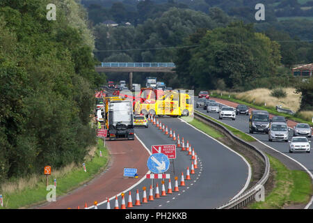 Moira, Northern Ireland, UK. 30 August 2018. An overturned lorry has caused major disruption on the M1 in Northern Ireland. The vehicle went off the motorway east of Moira on the citybound carriageway. Long tailbacks followed whilst the incident was tackled before the citybound carriageway was completely closed to allow the vehicle to be recovered and removed. Credit: David Hunter/Alamy Live News. - Stock Photo