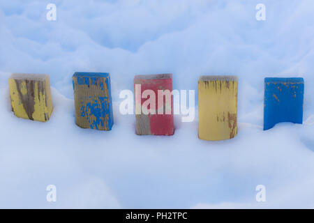 Textured Colorful Painted Blue, Red, Yellow Wooden Picket Fence Planks In Deep Snow, Colorful Rustic Style Background For Vintage Winter Season Wallpa - Stock Photo