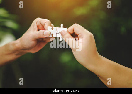 High view of businessmen solving jigsaw puzzle. Unity in the group Team work is important. - Stock Photo