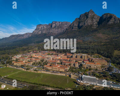 Aerial view of the University of Cape Town, Under the towering peaks of Devil's Peak. - Stock Photo