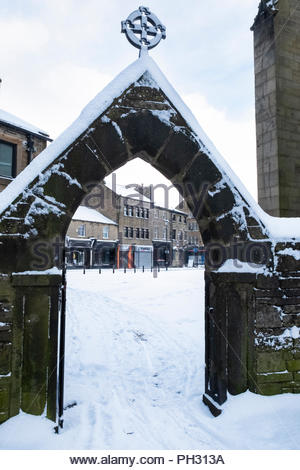 View through the lychgate at Keighley Church towards Church Street  Keighley West Yorkshire England UK Winter February 2018 - Stock Photo