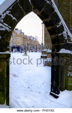 View through the lychgate at Keighley Church towards the market cross and North Street Keighley West Yorkshire England UK Winter February 2018 - Stock Photo